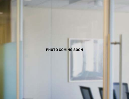 """Office background image with text """"Photo Coming Soon"""""""